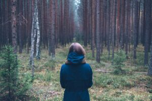 Woman trying to find her way through woods